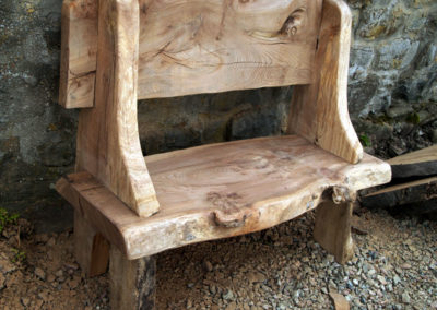 Garden bench with back constructed from elm