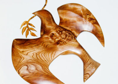 Dove of peace carving in burr elm and olive wood