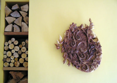 Floral wall-plaque carving in burr elm