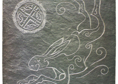 Running hare under harvest moon slate wall panel