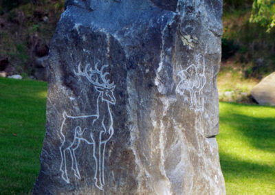 Pictish style standing stone with stag, eagle and salmon