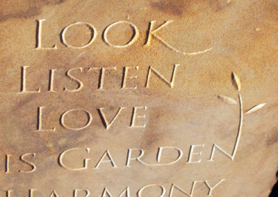 "Red squirrel and lettering carved in Moray ""Clashach"" sandstone"