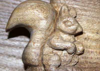 Celtic knotwork family of trees carved in Wych elm