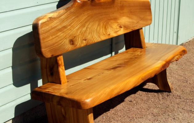 Carved garden patio bench in Scots Wych Burr Elm