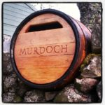 Hand-carved whisky barrel post box