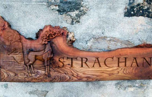 hand-carved lettering and stag wood house sign Strachan