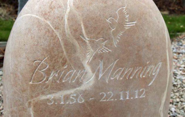 Hand-carved sandstone headstone memorial