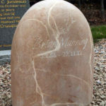 Hand-carved sandstone headstone memorial