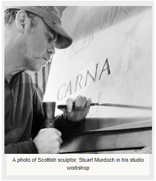 A photo of Scottish sculptor, Stuart Murdoch in his studio workshop