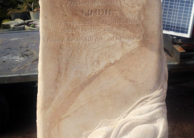 Unique hand-carved sandstone headstone with running water