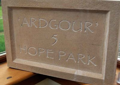 hand-carved lettering stone house sign Ardgour