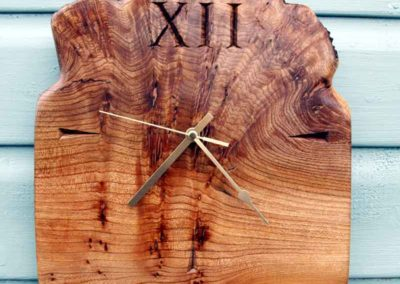 Hand-carved lettering on wooden clock, wedding gift
