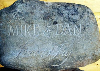River stone grave marker