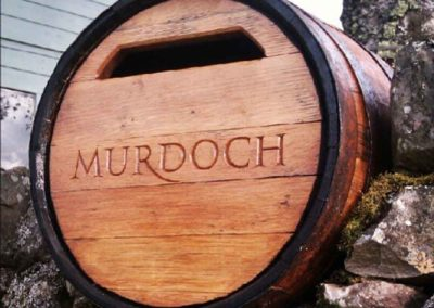 hand-carved lettering whisky barrel house sign post box