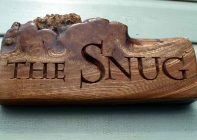 hand-carved lettering wood house sign The Snug